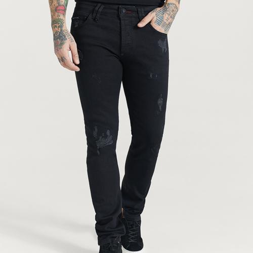 Svarta slitna jeans herr