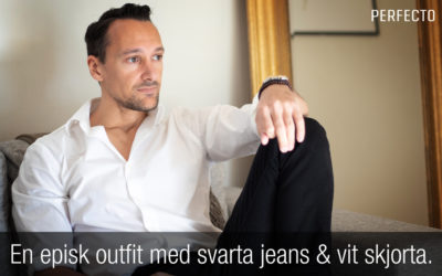 En episk outfit med svarta jeans och vit skjorta.